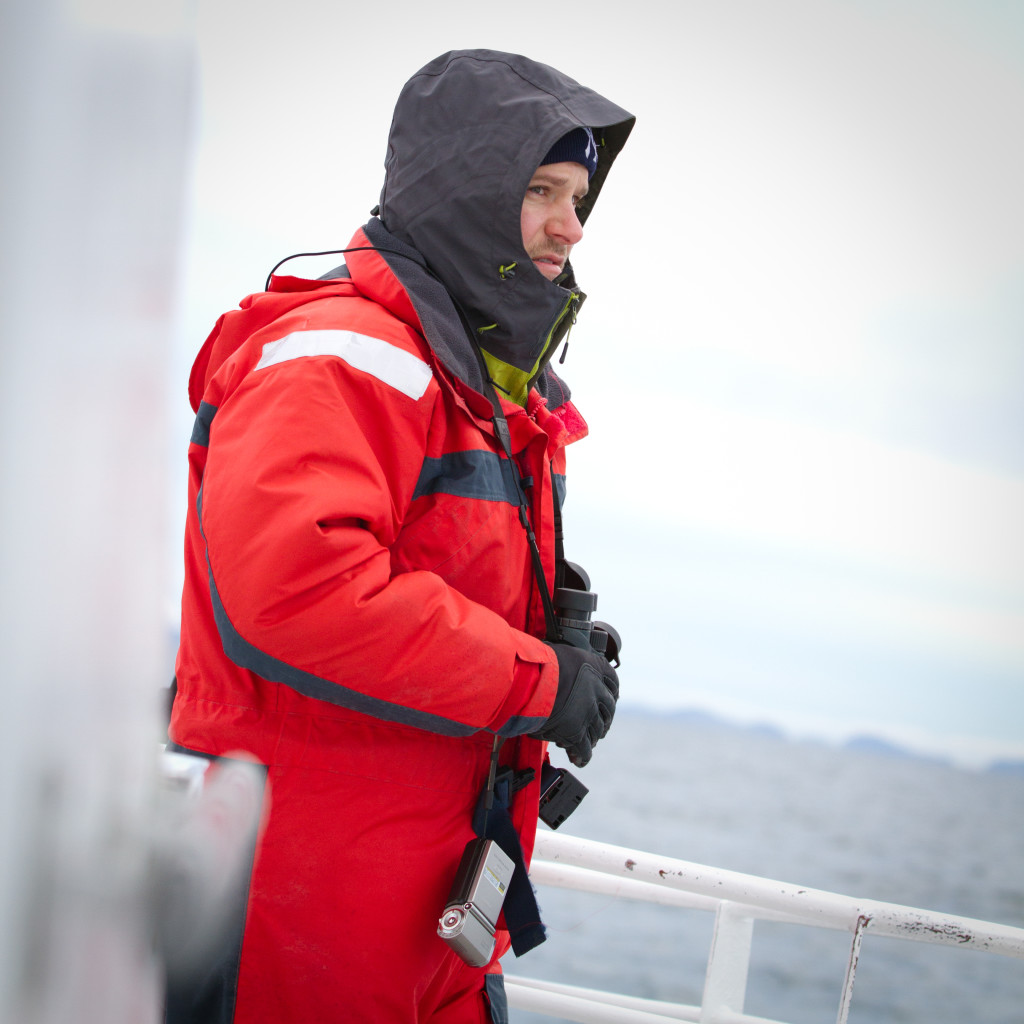 Bundled up on the boat while on a whale watching safari.
