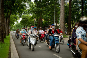Motorbikes rule the road in Vietnam.  When you want to cross the street, start walking, maintain the same speed...the bikes will go around you. For the most part...