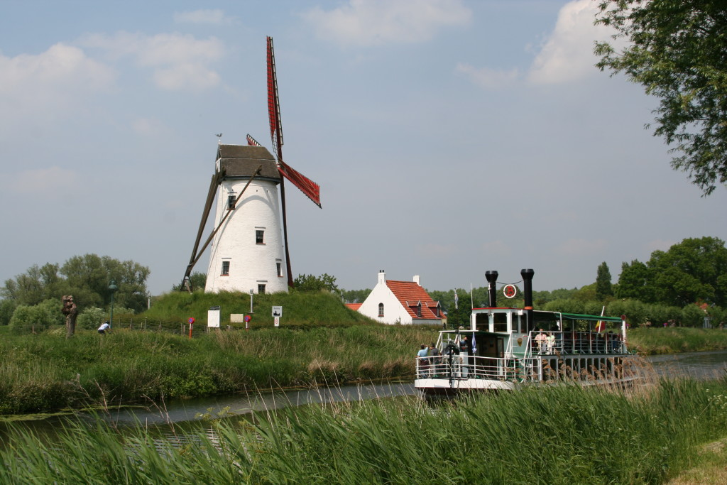 Riding along the canals we passed by windmills, river cruises and beefy Belgian Blue cows.